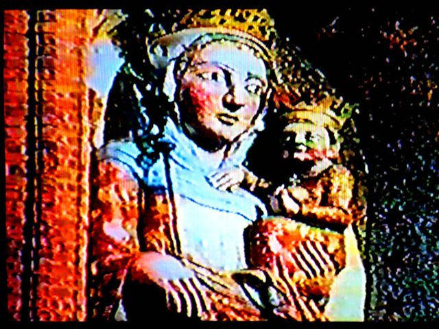 Fig. #C2b(middle): One frame from an old film showing the stucco statue of Virgin Mary from the Malbork Castle, together with the place where it used to stand.